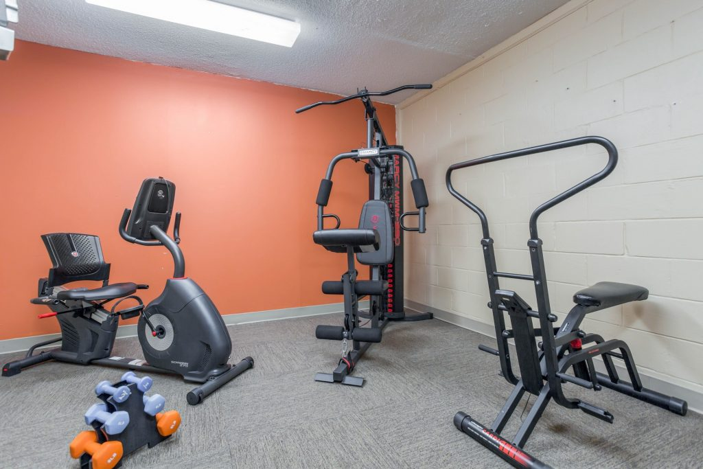 Fitness room with variety of exercise machines and equipment